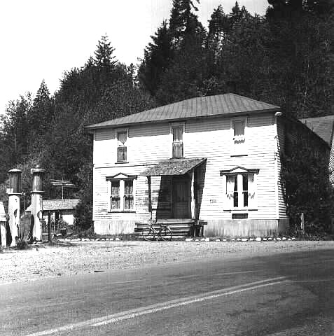 Dolph hotel and 2 gas pumps